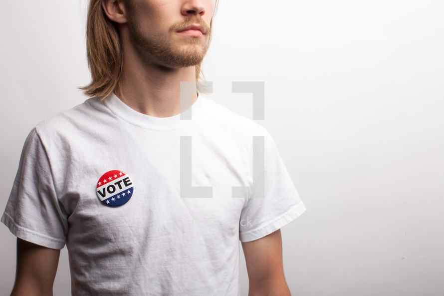 young man wearing a vote button