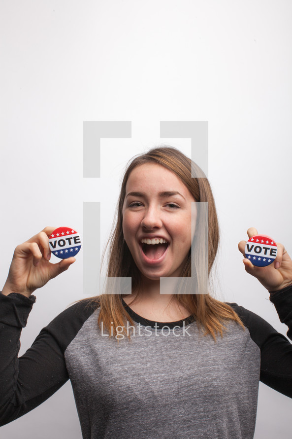 young woman holding vote button