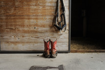 cowboy boots in a stable