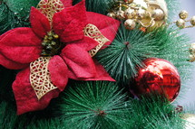 poinsettia ornament on a Christmas tree