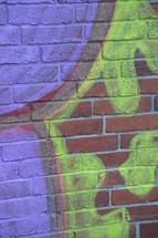 Graffiti on a brick wall.
