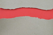 red under torn paper with copy space - ripped paper revealing light red blank space for words