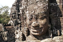 buddhist sculpturea in towers of Bayon temple