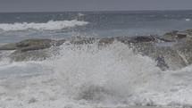 Ocean waves crashing on a rocky shore.