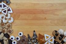 border of christmas cookies on breadboard