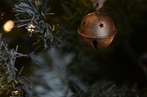 bell ornament on a Christmas tree