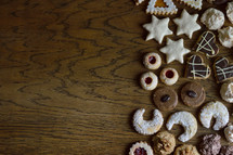 cookie assortment on wooden table as border