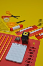 office supplies in red and yellow