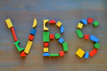 colorful wooden toy blocks with VBS