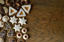 cookie assortment on wooden table as border or frame