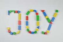 word joy of colorful toy wooden blocks
