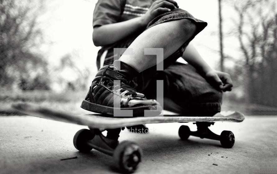 legs on a teen boy on a skateboard