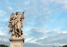 Statue of an angel standing on the bridge leading to the Castle Sant'Angelo, Rome.