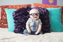 infant boy wearing a tie t-shirt and glasses
