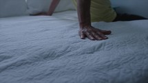 person sitting on a bed