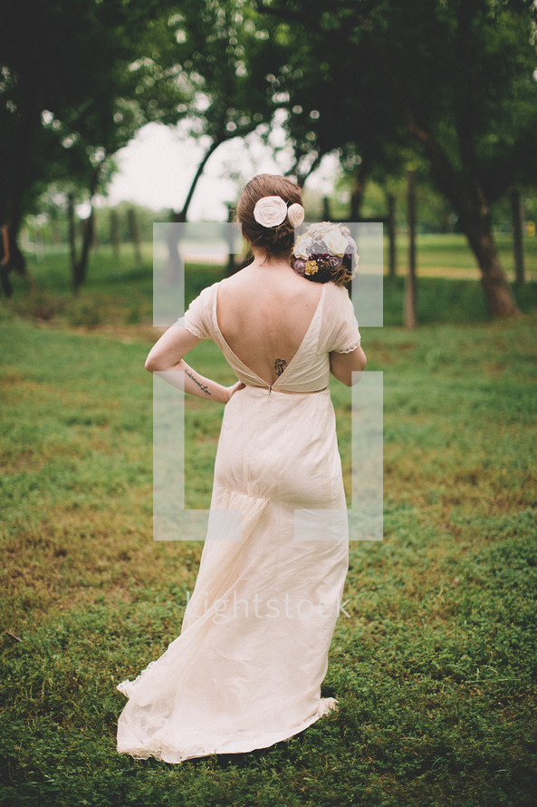 back of woman holding a bouquet of flowers - bride - bridesmaid