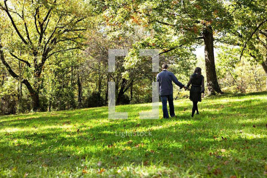 Couple in park holding hands