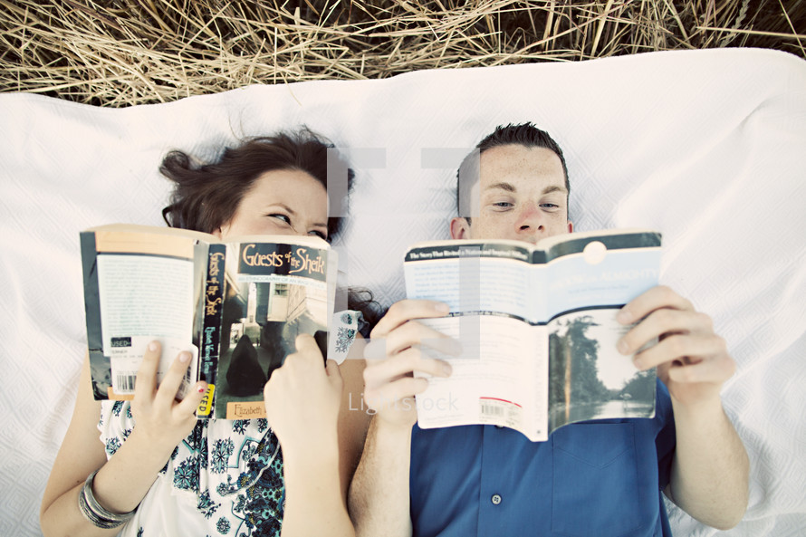 Happy couple reading Blakey field love romance relationship