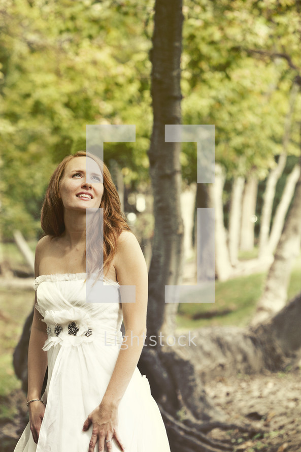 A bride smiling and looking up