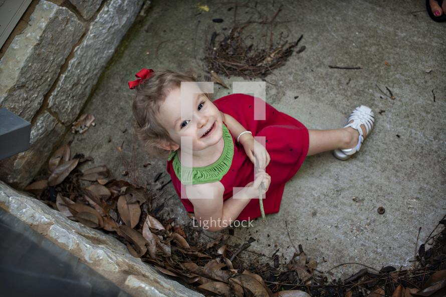 little girl in a watermelon dress