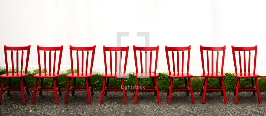 Row of red chairs outside