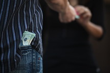 cash in a man's back pocket