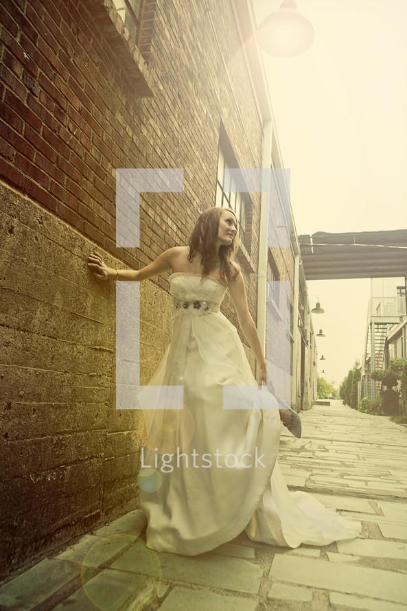 Bride in alleyway