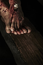 Jesus' feet nailed to the cross