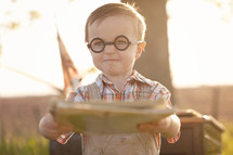 A little boy wearing glasses