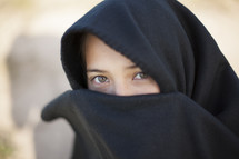 eyes of a shrouded woman