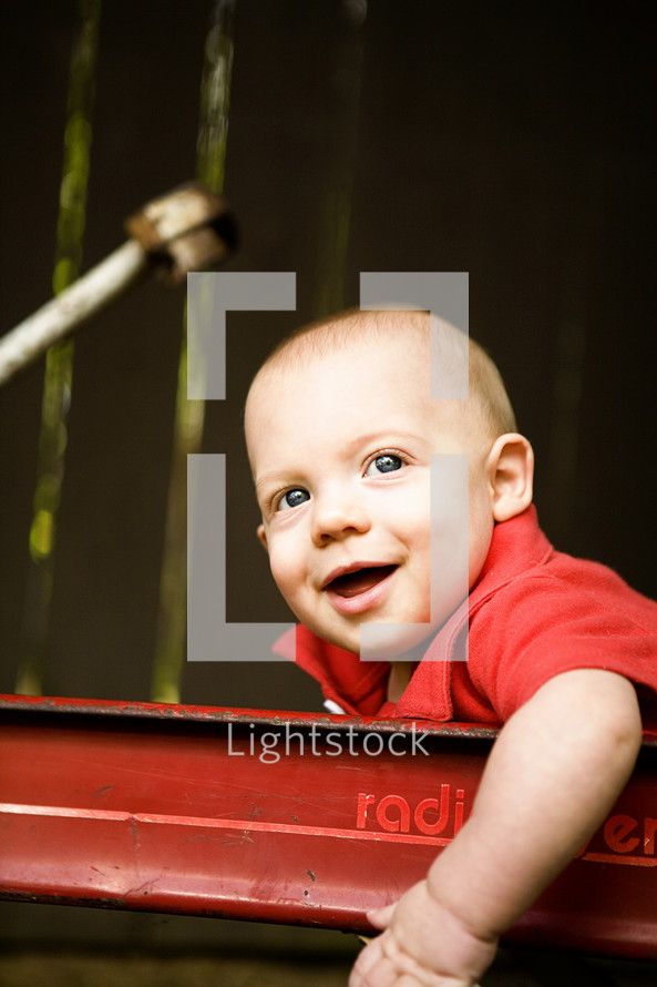 Happy toddler boy in wagon
