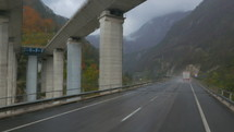 vehicle traveling on a wet rainy road