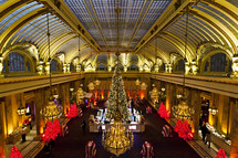 large Christmas tree in a grand hotel lobby