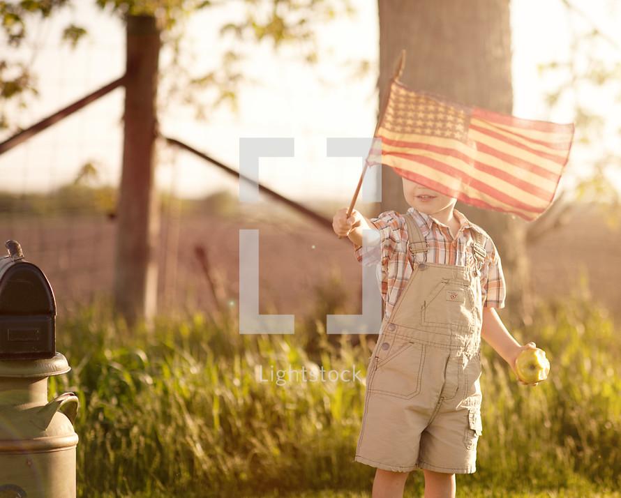 toddler boy waving an American flag