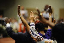 Raised hands during a worship service.