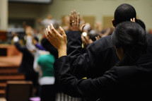 hands raised in worship at a church service