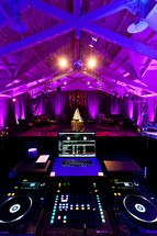 Wedding reception view  DJ station cake lighting celebration party event