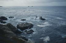 Ocean waves crashing over the rocks