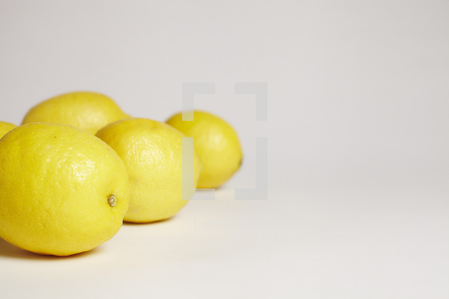 A group of lemons isolated on white.