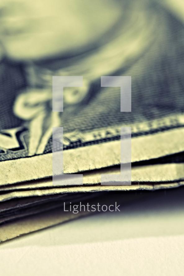 A stack of ten dollar bills