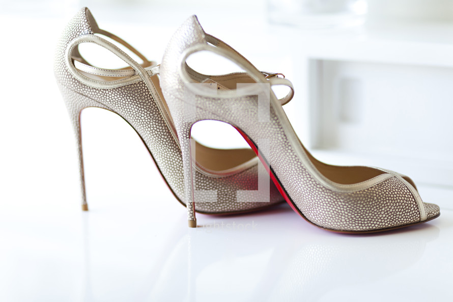 A pair of high heeled shoes wedding stiletto expensive Louis Vuitton