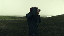 woman with a camera taking pictures in Iceland and view from a drone