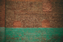 Brick wall with turquoise paint strip