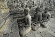 Line of statues of Buddha at Borobdur, Indonesia