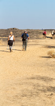 people exploring a desert