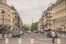 busy streets in Paris and concrete barriers