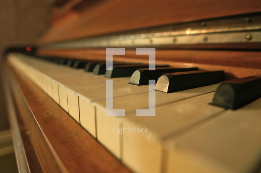 Closeup of ebony and ivory keys on an antique piano