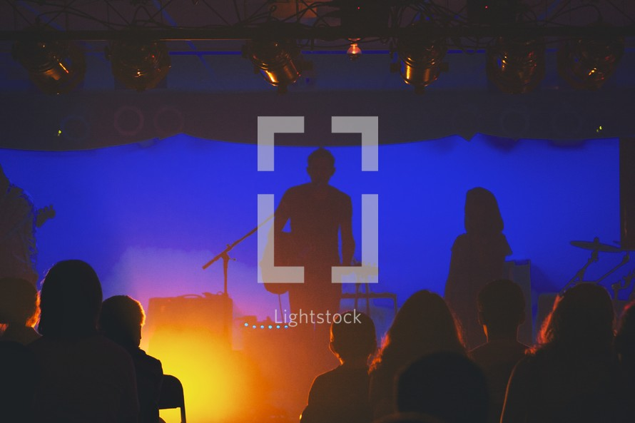 silhouette of a musician on stage