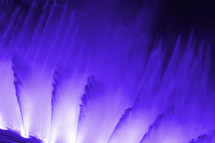 purple fountains of water dancing to music