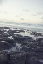 ocean water washing onto rocks